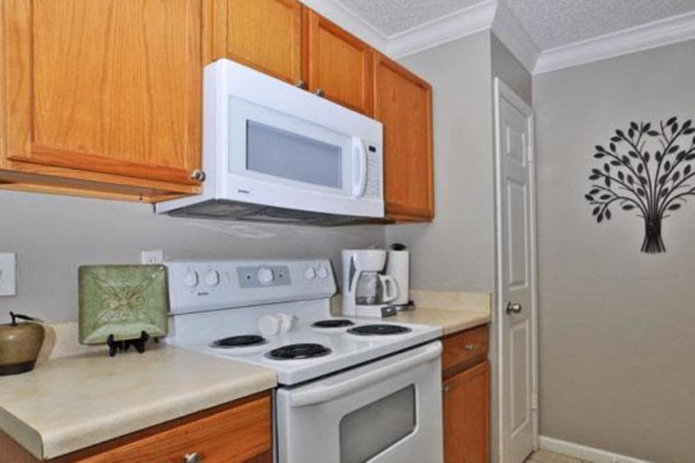Fully-equipped kitchen at French Colony Apartments in Lafayette, Louisiana