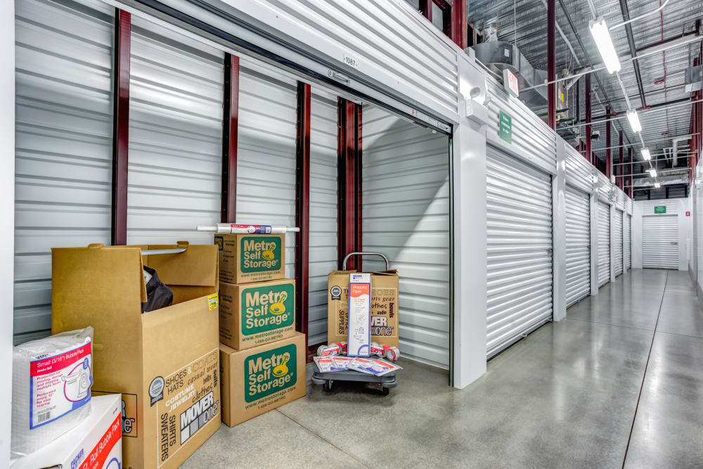Indoor storage unit with sample boxes inside at Metro Self Storage in St. Charles