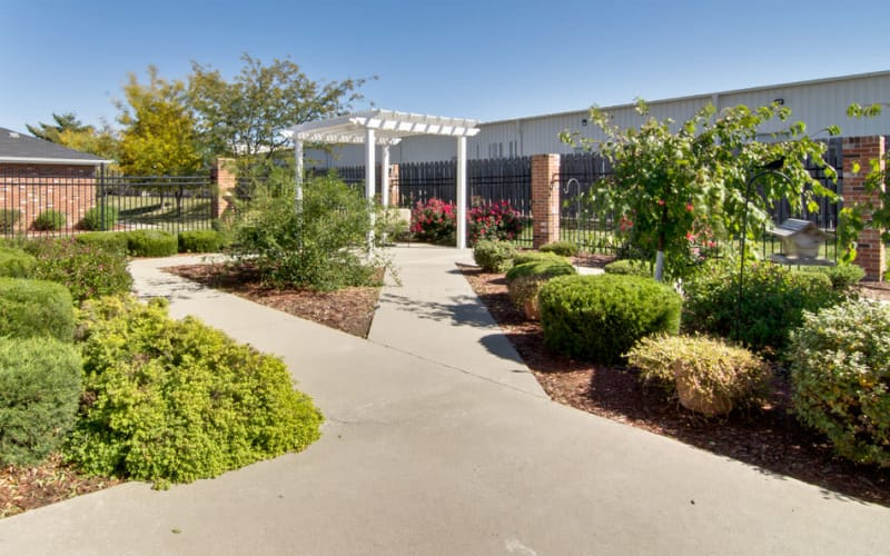 Outdoor walkway with beautiful landscaping at Westport Estates Senior Living in Marshall, Missouri