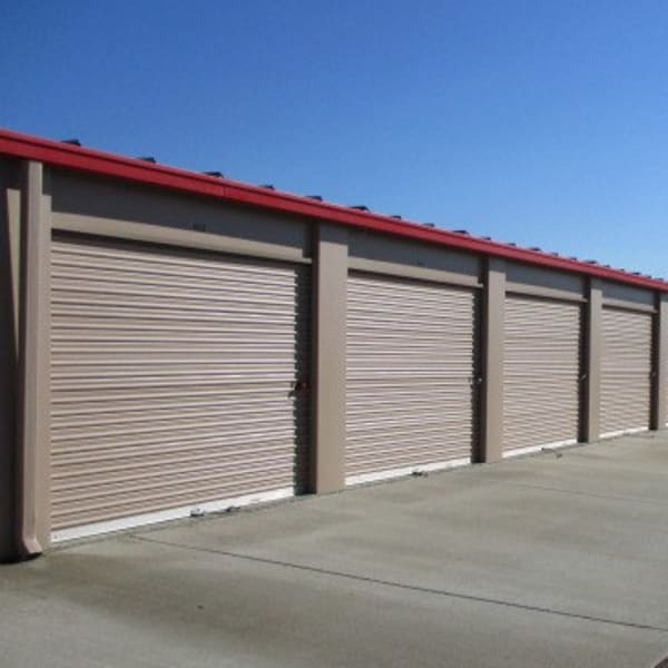 Outdoor storage units with drive-up access at StorQuest Self Storage in Ripon, California