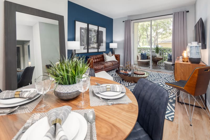 Living room with porch access at Luxe at 1820 in Tampa, Florida