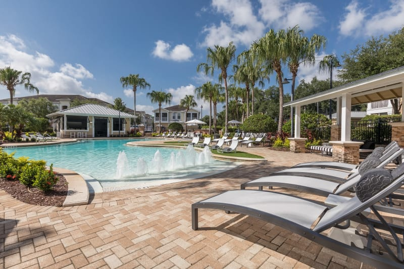 Resort style pool with lounge chairs at Luxe at 1820 in Tampa, Florida