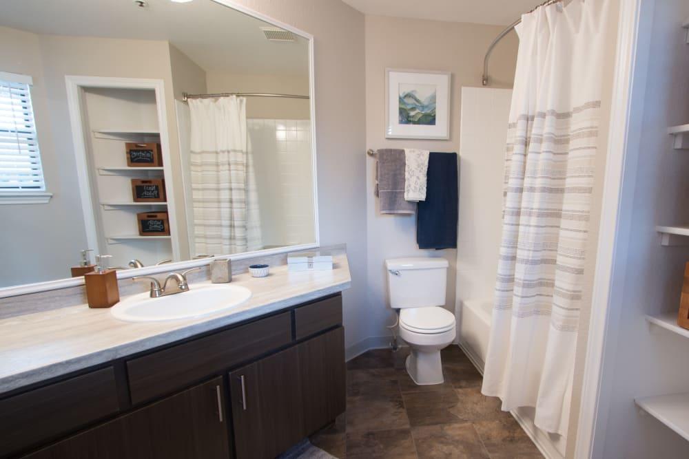 Master bathroom with plenty of storage space at Ashford Belmar in Lakewood, Colorado
