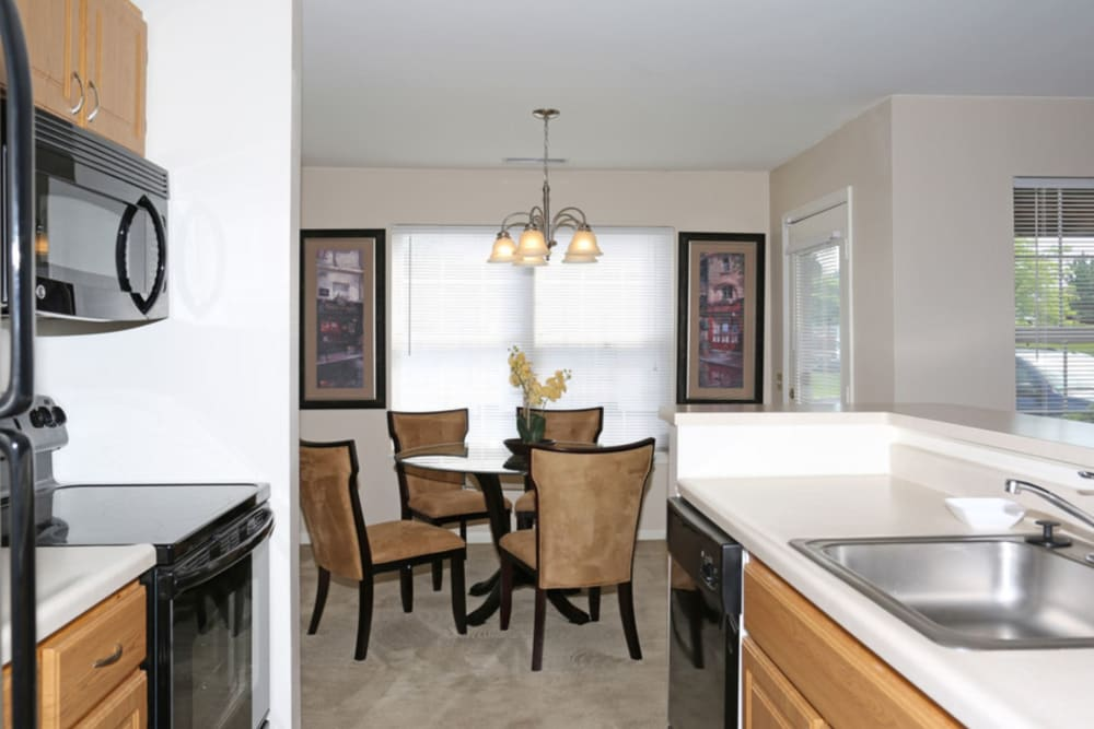 Kitchen and dining room at Bennington Hills Apartments in West Henrietta, New York