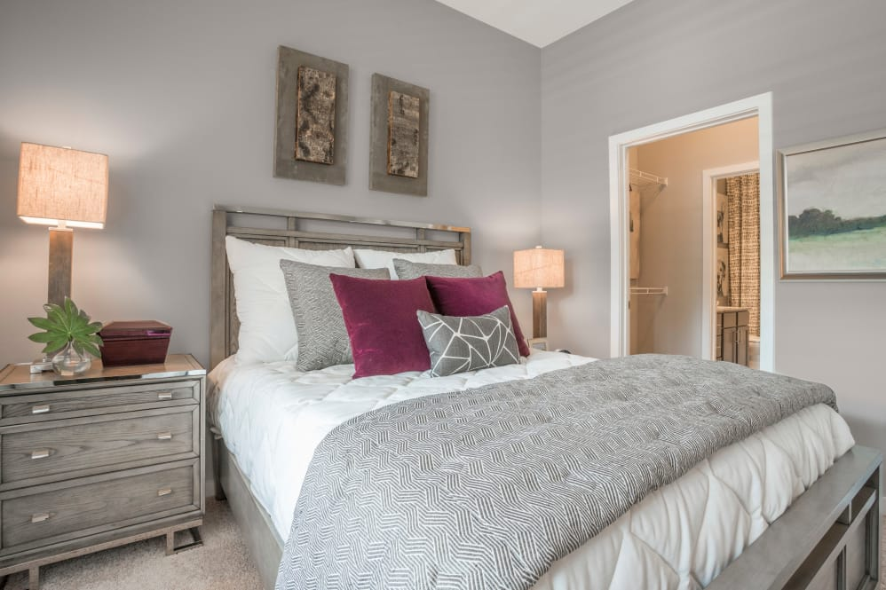 Enjoy apartments with a cozy bedroom at Alta Citizen