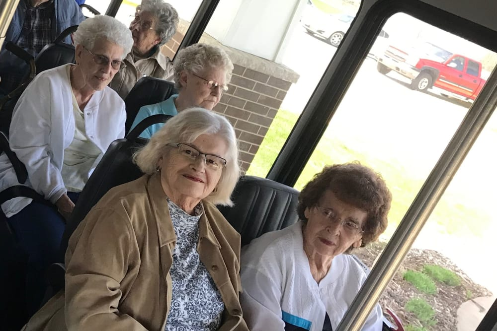 Residents take a bus ride to town at Prairie Hills in Independence, Iowa.