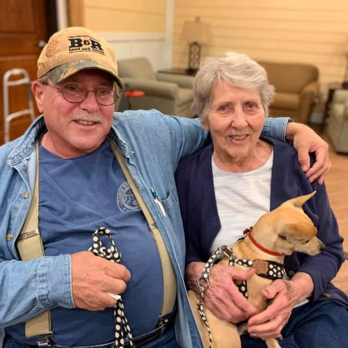 resident couple sitting with their dog at Oxford Glen Memory Care at Owasso in Owasso, Oklahoma