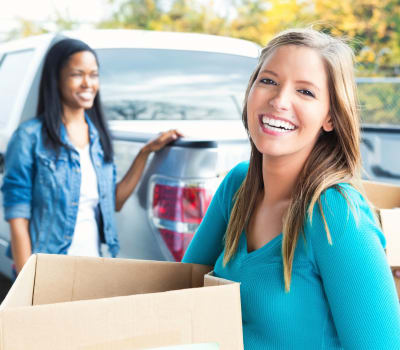 People arriving with moving boxes at Jacksonville Mini Warehouse in Jacksonville, North Carolina