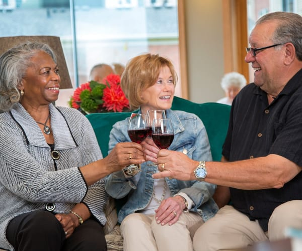Residents having wine at All Seasons of West Bloomfield in West Bloomfield, Michigan