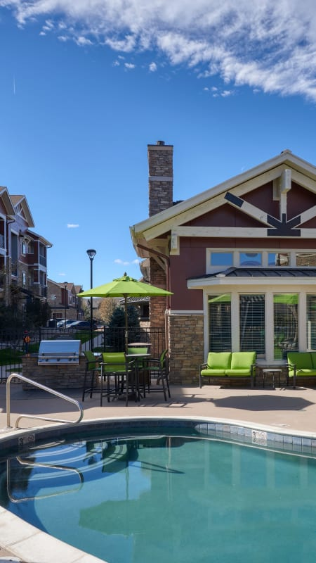 Pool area with lounges at M2 Apartments in Denver
