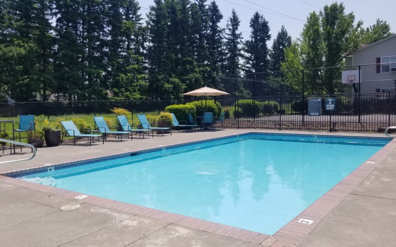 Enjoy swimming in the community swimming pool at The Landings at Morrison Apartments in Gresham, Oregon