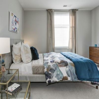 Bright furnished bedroom at Metropolitan Rockville Town Center in Rockville, Maryland