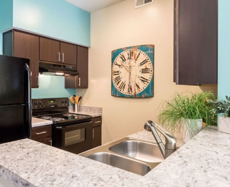 Dark wood cabinets in an apartment kitchen at Heritage Green in Hilliard, Ohio