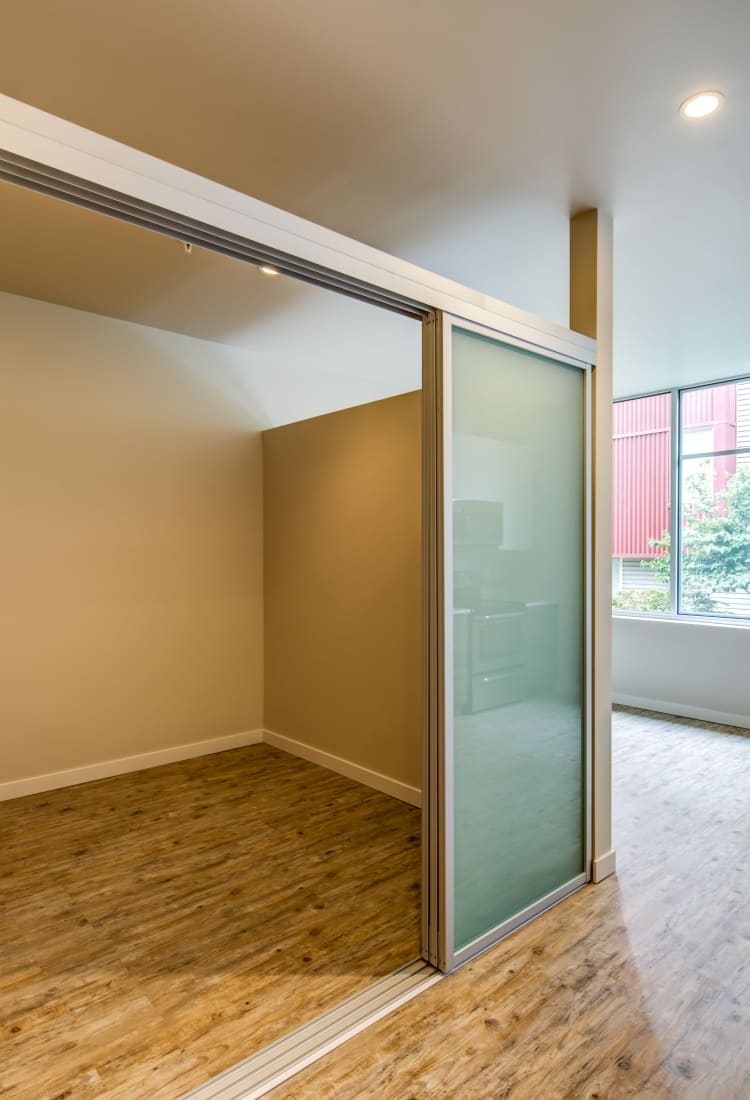 Open-concept layout with hardwood flooring and an office area in a model home at Verse Seattle in Seattle, Washington