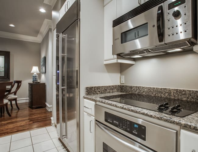 Fully equipped kitchen at Rienzi at Turtle Creek Apartments in Dallas, Texas