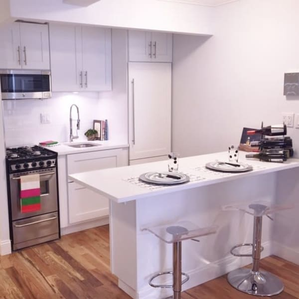Studio apartment kitchen with cabinetry at 210-220 E. 22nd Street in New York, New York