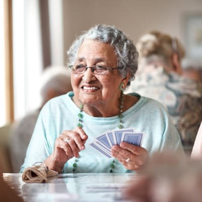 Residents playing cards at Retirement Center Management in Houston, Texas