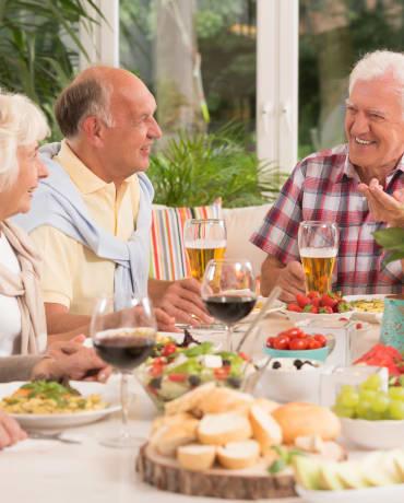 A family eating dinner at Honeysuckle Senior Living in Hayden, Idaho