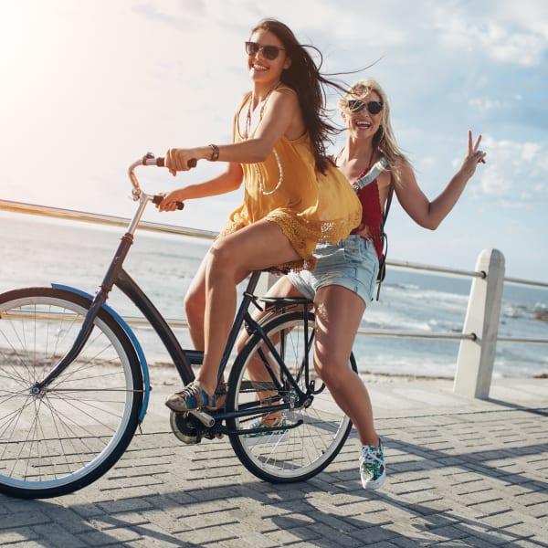 Residents on a bike ride along the water near Town Lantana in Lantana, Florida