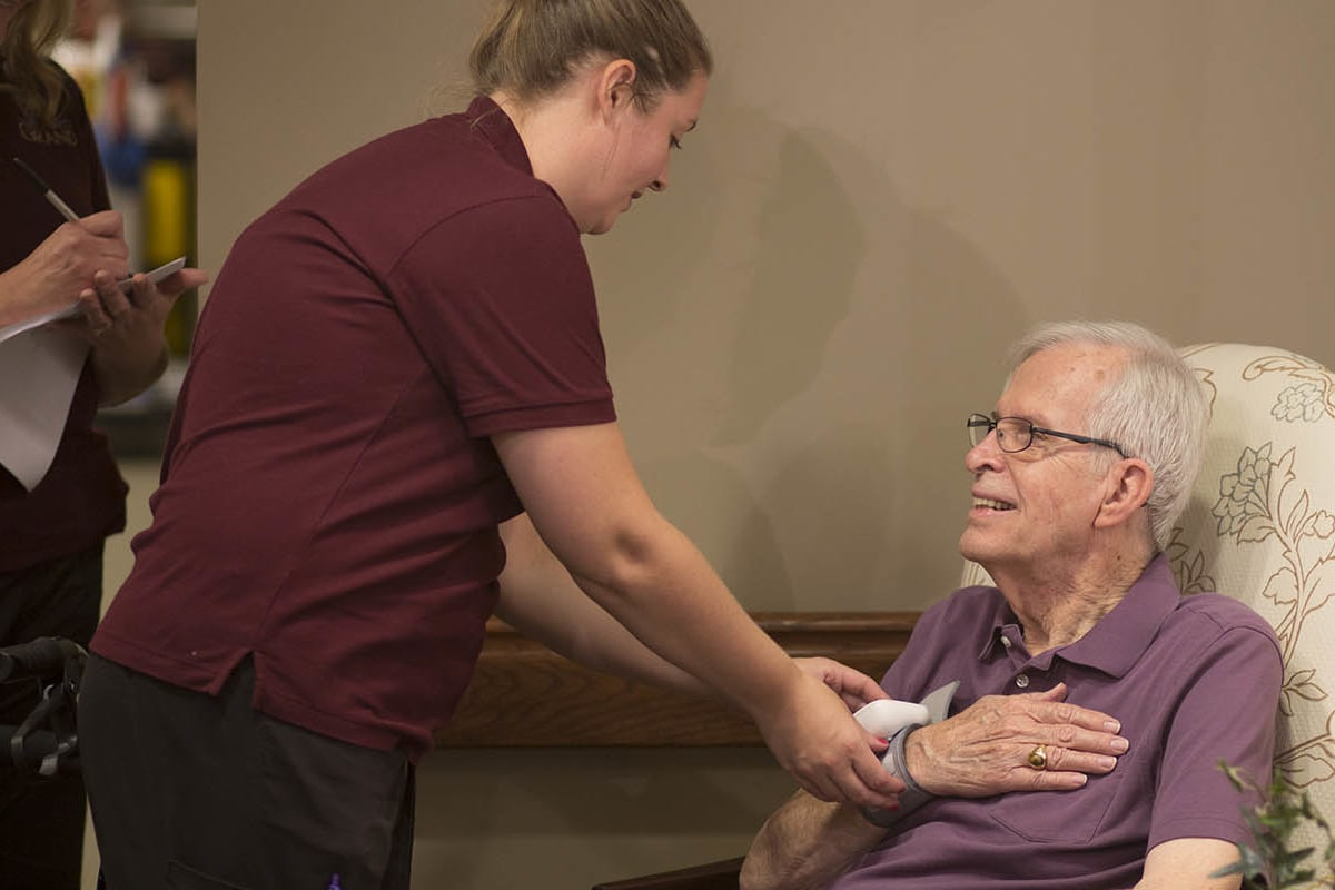 A resident and staff at The Oxford Grand Assisted Living & Memory Care in Kansas City, Missouri