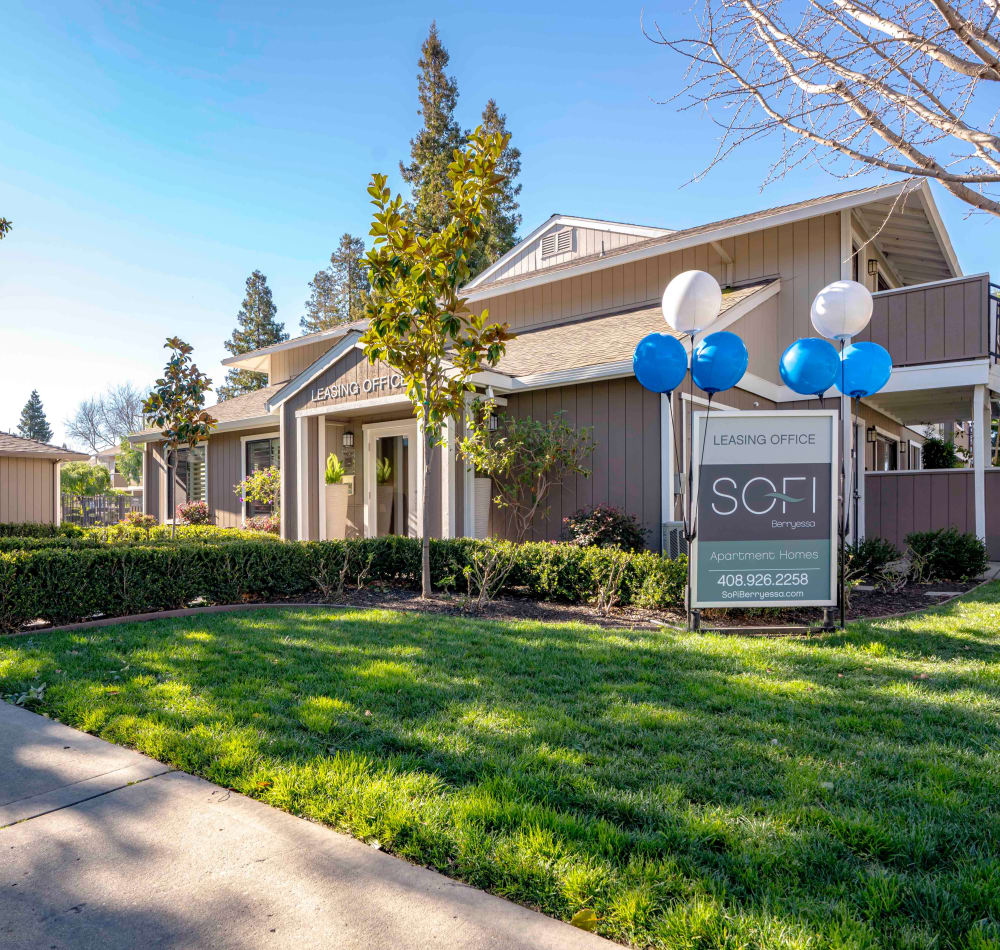 Professionally maintained landscaping outside the leasing center at Sofi Berryessa in San Jose, California