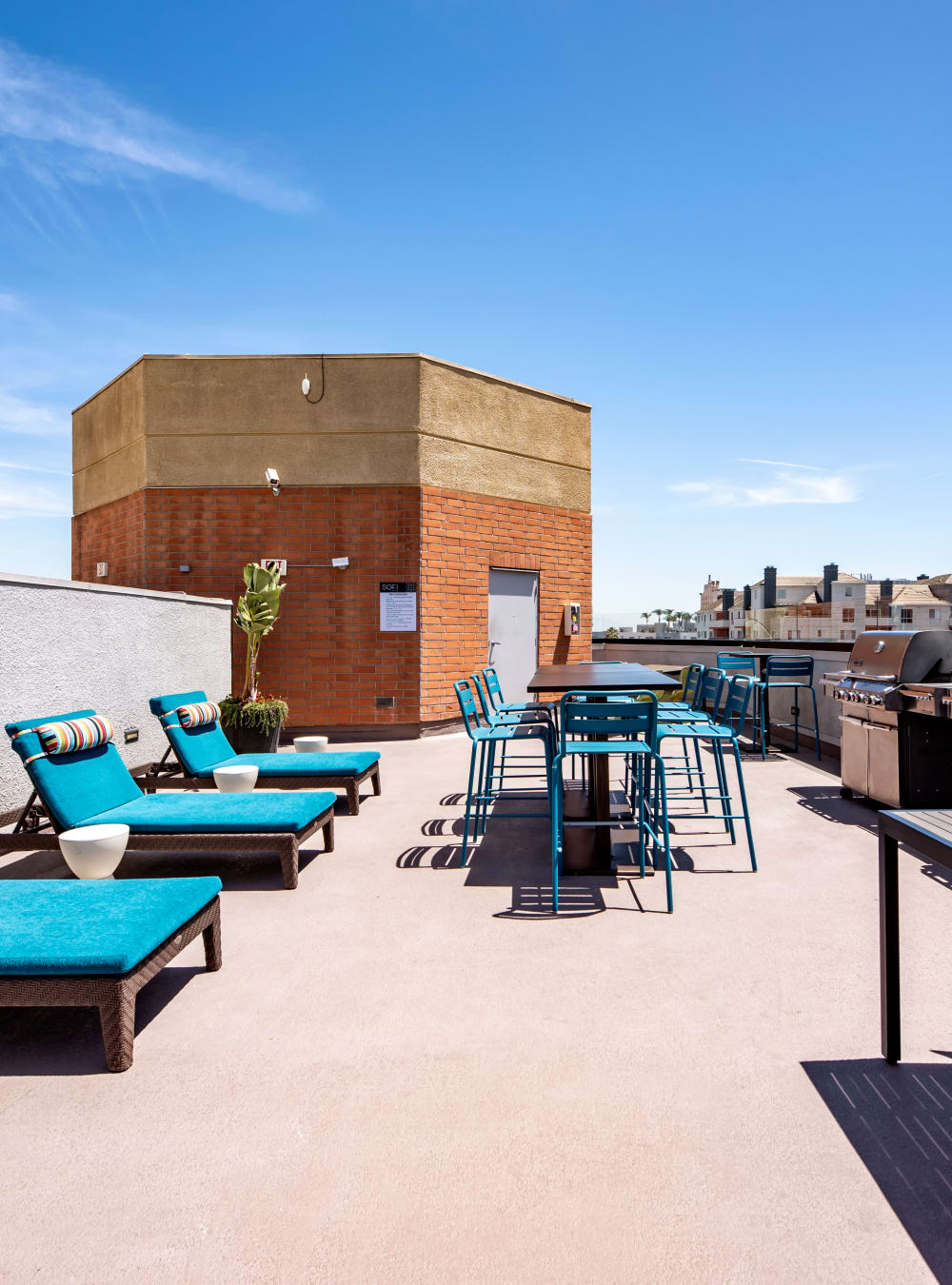 Rooftop lounge area with gas barbecue grills at Sofi at 3rd in Long Beach, California