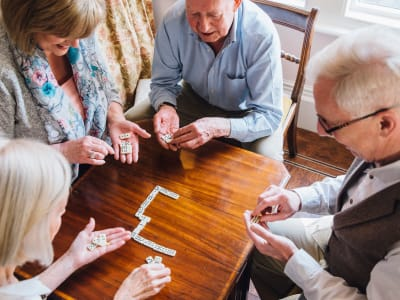 Residents playing majong at Randall Residence of Encore Village in Brighton, Michigan