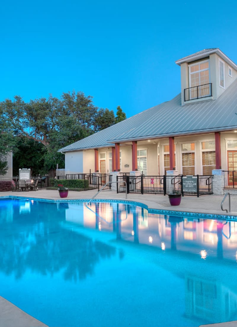 Pool and clubhouse at sunset at Marquis Bandera in San Antonio, Texas