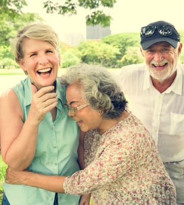 Happy residents hugging at Blossom Vale Senior Living in Orangevale, California