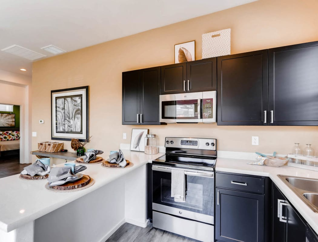 Luxury kitchen and dining area at Avilla Lehi Crossing apartment in Mesa, Arizona