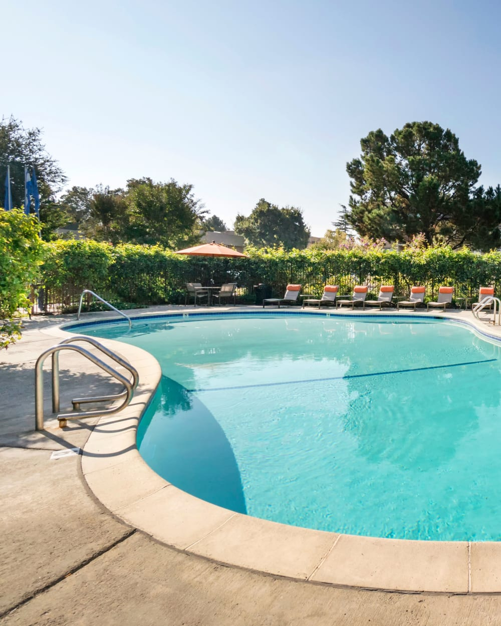 Swimming pool area on a peaceful sunny morning at Waterstone Fremont in Fremont, California