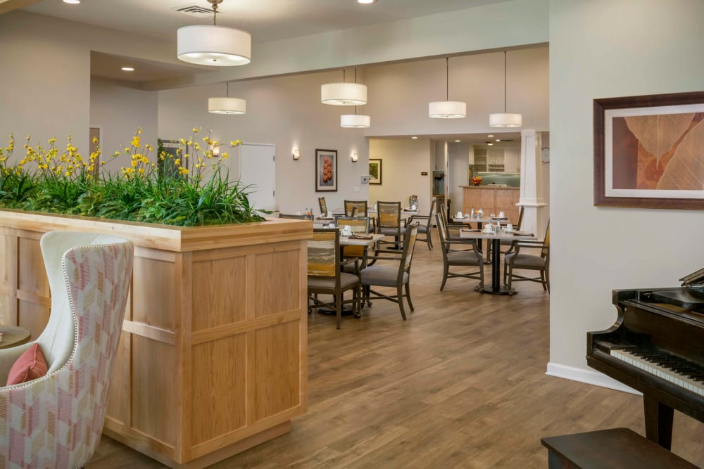 Lounge are with card times, comfortable seating and a piano at The Springs at Clackamas Woods in Milwaukie, Oregon
