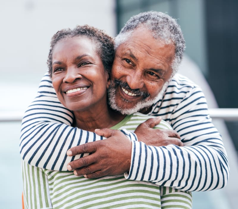A resident couple embraces at The Sanctuary at West St. Paul in West St. Paul, Minnesota
