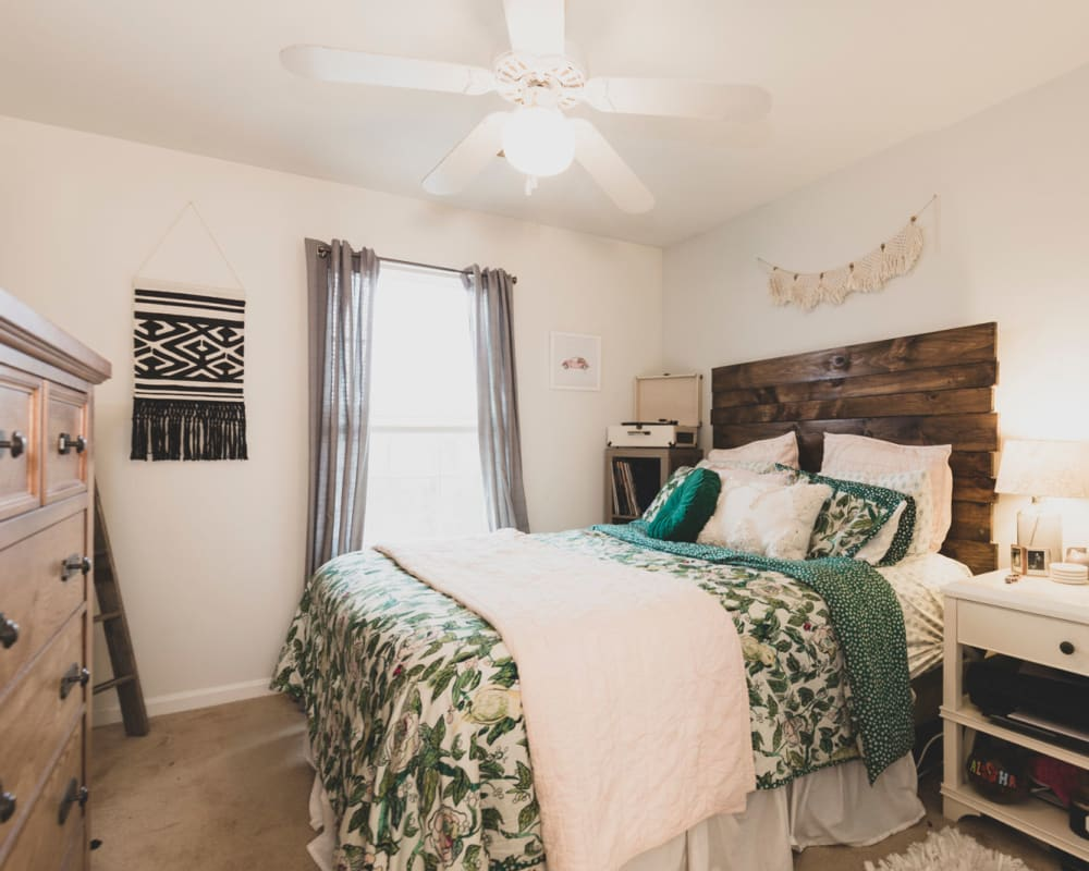 Spacious master bedroom with plush carpeting at Sunchase at Longwood in Farmville, Virginia