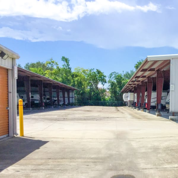Covered RV and boat parking at StorQuest Self Storage in Friendswood, Texas