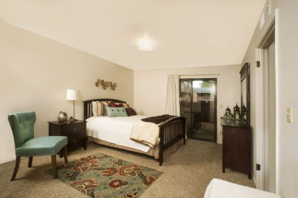 Master bedroom with modern decor at Pine Tree Apartments in Chico, California