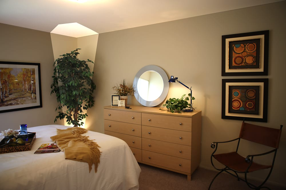 Well-lit bedroom in model home at Kensington Manor Apartments in Farmington, Michigan