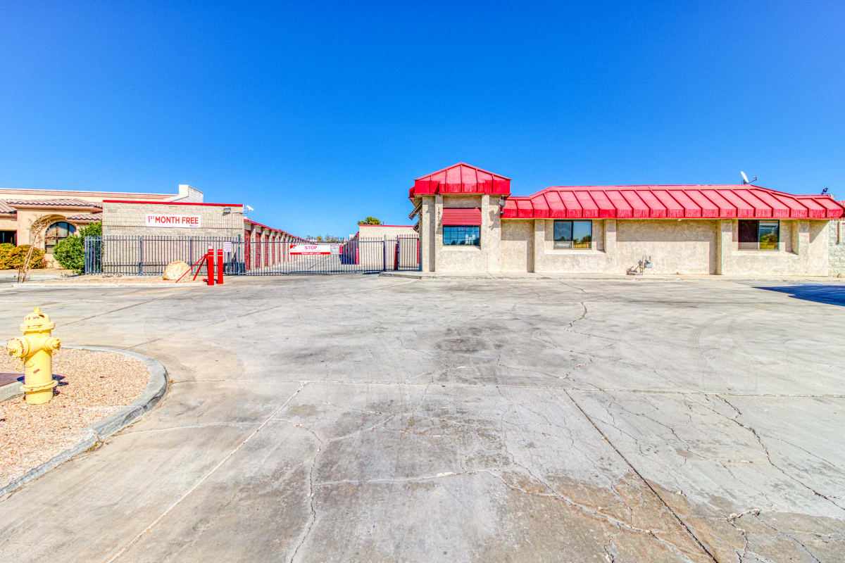 Open driveways and large parking spaces at Devon Self Storage in Apple Valley, California