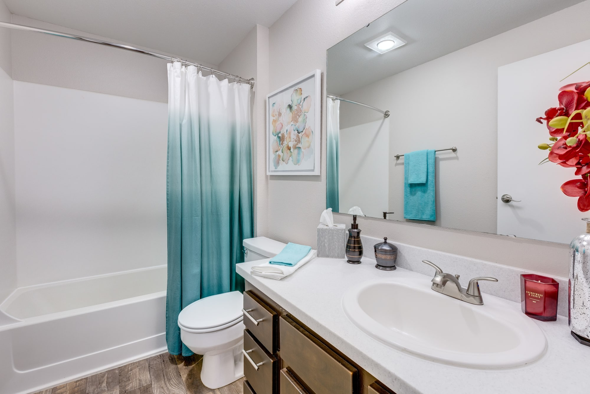 A bathroom with a white counter top and large mirror at Cascade Ridge in Silverdale, Washington