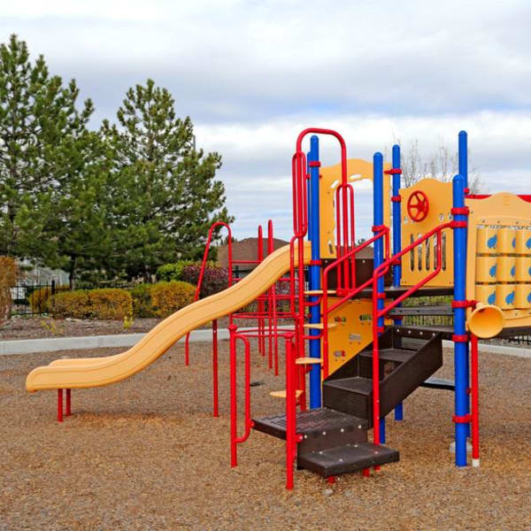 Children's playground with two slides at Northwind Apartments in Reno, Nevada