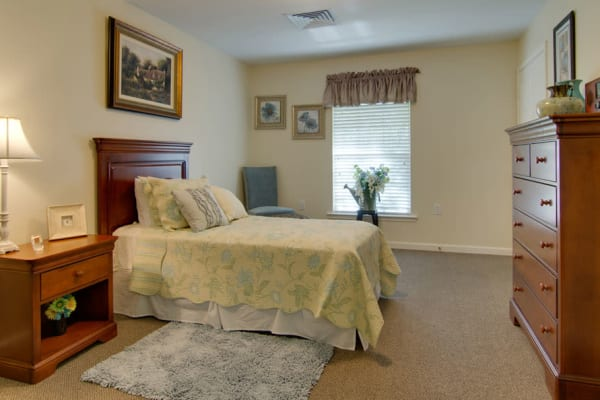 Assisted living apartment bedroom at Chestnut Glen Senior Living in Saint Peters, Missouri