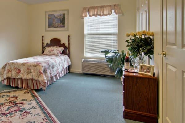 Assisted living apartment bedroom at Harmony Hill in Huntingdon, Tennessee