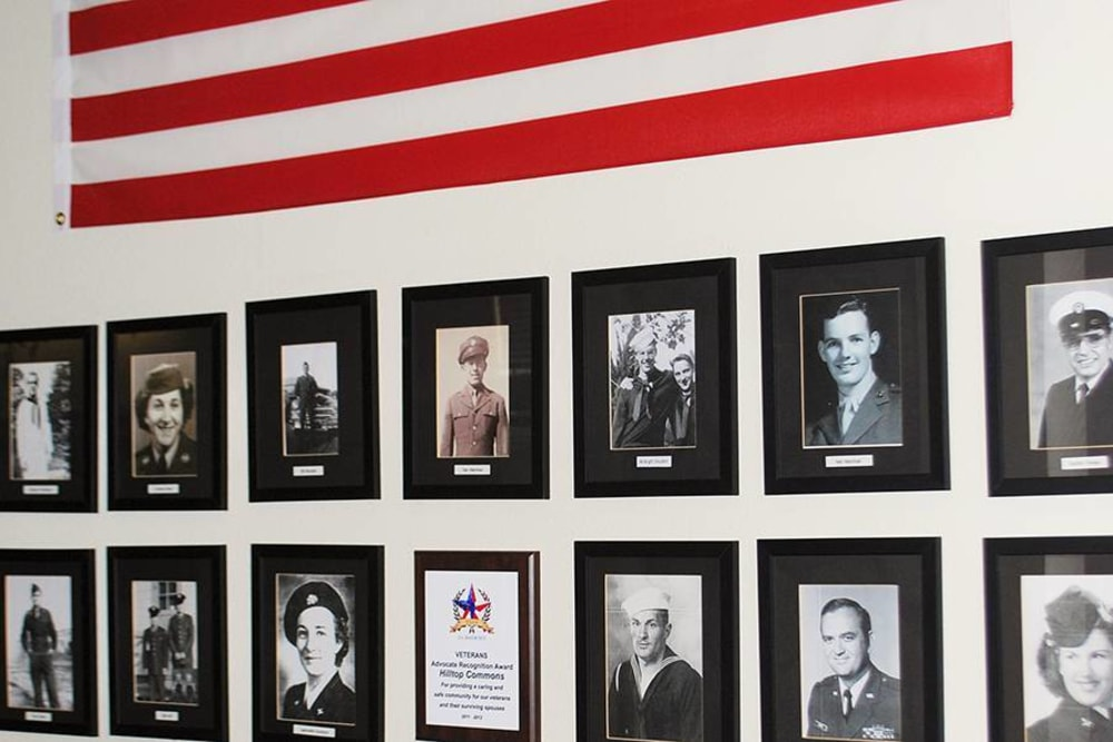 Wall of Veterans photos at Hilltop Commons Senior Living in Grass Valley, California