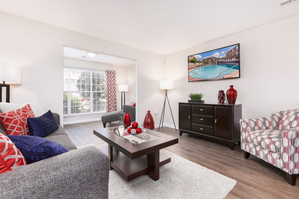 Spacious living room area with tons of light and wood style flooring at Ascend @ 1801 in Charlotte, North Carolina