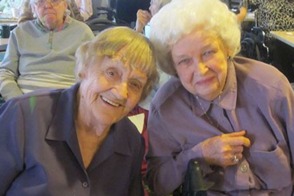 Two smiling friends at Avalon Assisted Living Community in Fitchburg, Wisconsin