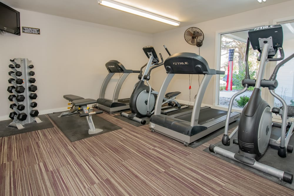 Well equipped fitness center at Aspen Park Apartments in Wichita, Kansas