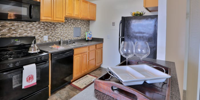 Well equipped kitchen at Kings Park Plaza Apartment Homes in Hyattsville, Maryland