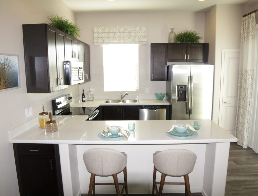 Avilla Town Square showcases a beautiful kitchen with breakfast bar in Gilbert, Arizona