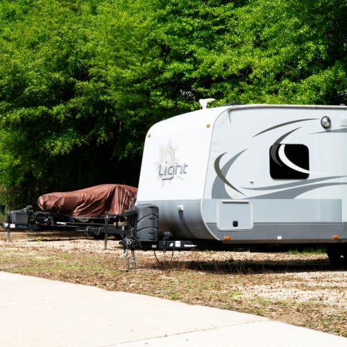 Outdoor RV and automobile parking at Red Dot Storage in Denham Springs, Louisiana