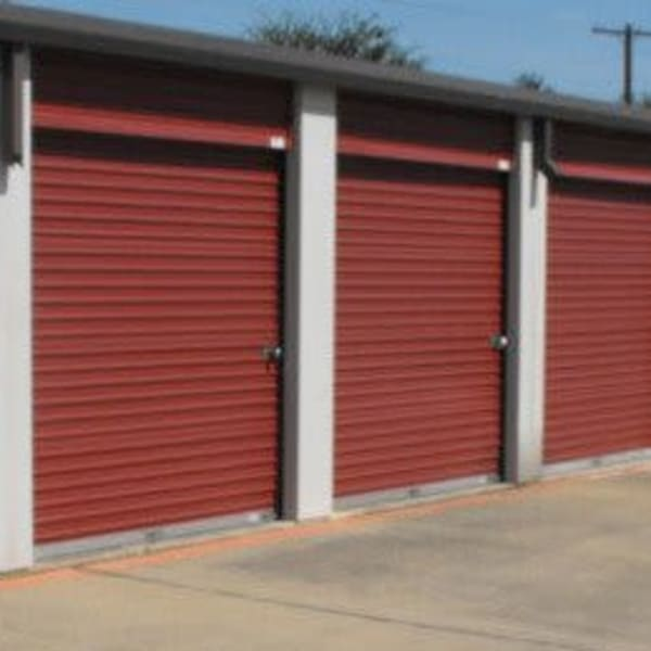 Exterior units with red doors at StorQuest Self Storage in Dallas, Texas
